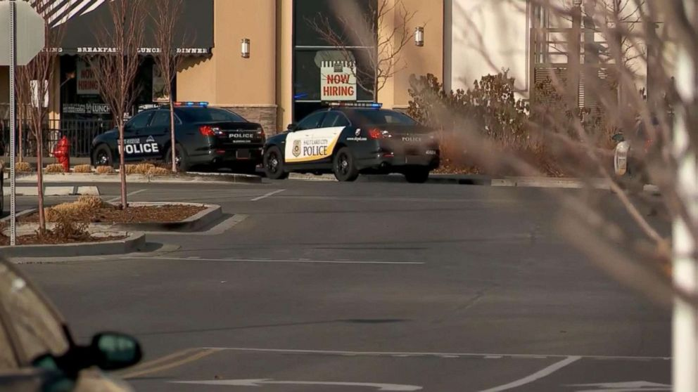 Authorities respond to a shooting that injured two people at the Fashion Place Mall in Murray, Utah, Jan. 13, 2019.