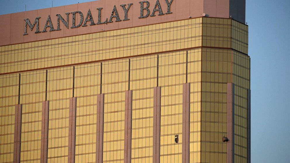 Drapes billow out of broken windows at the Mandalay Bay resort and casino on the Las Vegas Strip, Oct. 2, 2017, following a deadly shooting at a music festival.