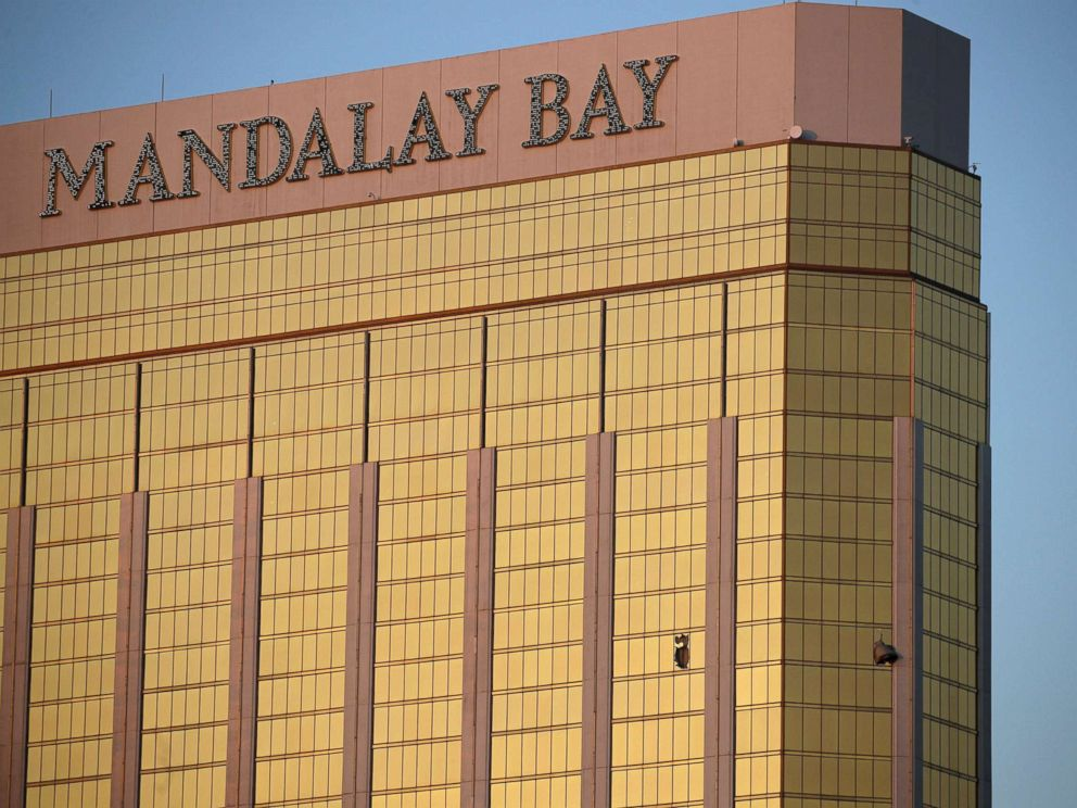 PHOTO: Drapes billow out of broken windows at the Mandalay Bay resort and casino on the Las Vegas Strip, Oct. 2, 2017, following a deadly shooting at a music festival.