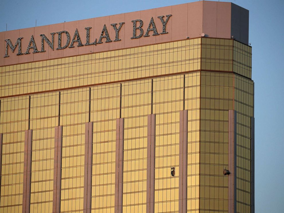 PHOTO: Drapes billow out of broken windows at the Mandalay Bay resort and casino on the Las Vegas Strip, Oct. 2, 2017, following a deadly shooting at a music festival.  911 calls from Las Vegas shooting reveals chaos, panic that ensued as gunman opened fire manadalay bay windows ap ps 171207 hpMain 4 4x3 992