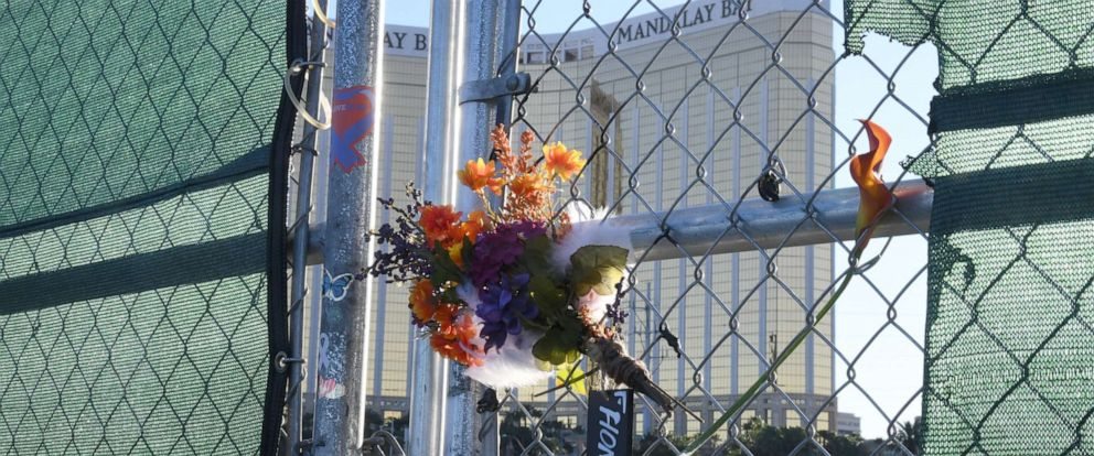 "PHOTO: Flowers and a sign reading ""HONOR 58"" hang on a fence outside the Las Vegas Village across from Mandalay Bay Resort and Casino as a tribute to those killed almost two years ago in a massacre at the site on Sept. 30, 2019, in Las Vegas."