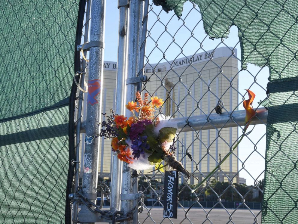 PHOTO: Flowers and a sign reading HONOR 58 hang on a fence outside the Las Vegas Village across from Mandalay Bay Resort and Casino as a tribute to those killed almost two years ago in a massacre at the site on Sept. 30, 2019, in Las Vegas.