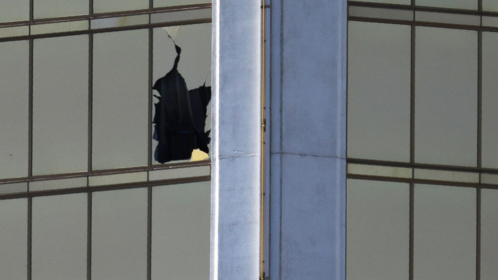 A broken window is seen at The Mandalay Bay Resort and Casino following a mass shooting at the Route 91 Festival in Las Vegas, Oct. 2, 2017.