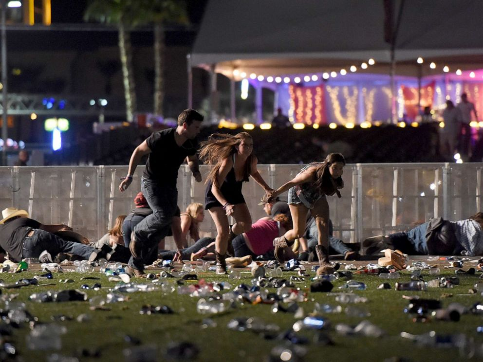 PHOTO: People run from the Route 91 Harvest country music festival after apparent gun fire was heard, Oct. 1, 2017, in Las Vegas.