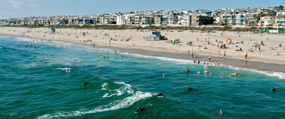 PHOTO: This stock photo depicts swimmers and surfers enjoying the water in Manhattan Beach, California.