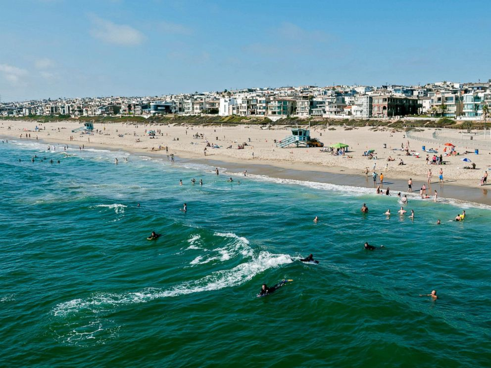 Photo This Stock Depicts Swimmers And Surfers Enjoying The Water In Manhattan Beach