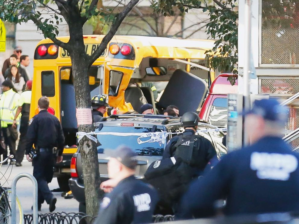 PHOTO: Authorities respond near a damaged school bus, Oct. 31, 2017, in New York.