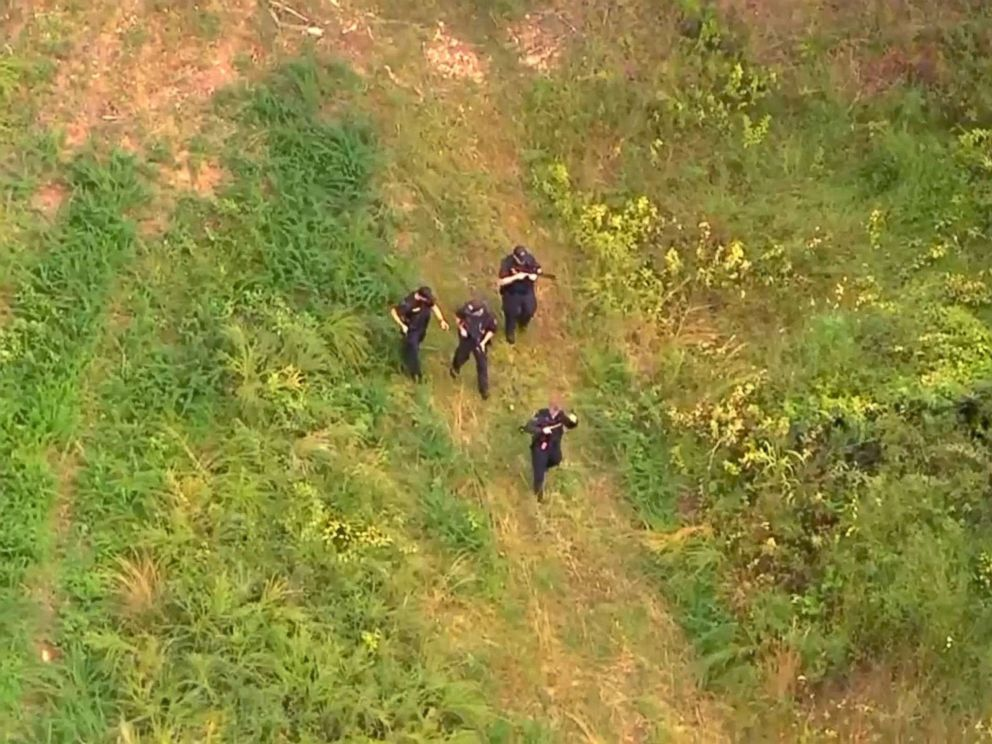 PHOTO: A manhunt intensifies for Tennessee murder suspect as potential sighting is reported.