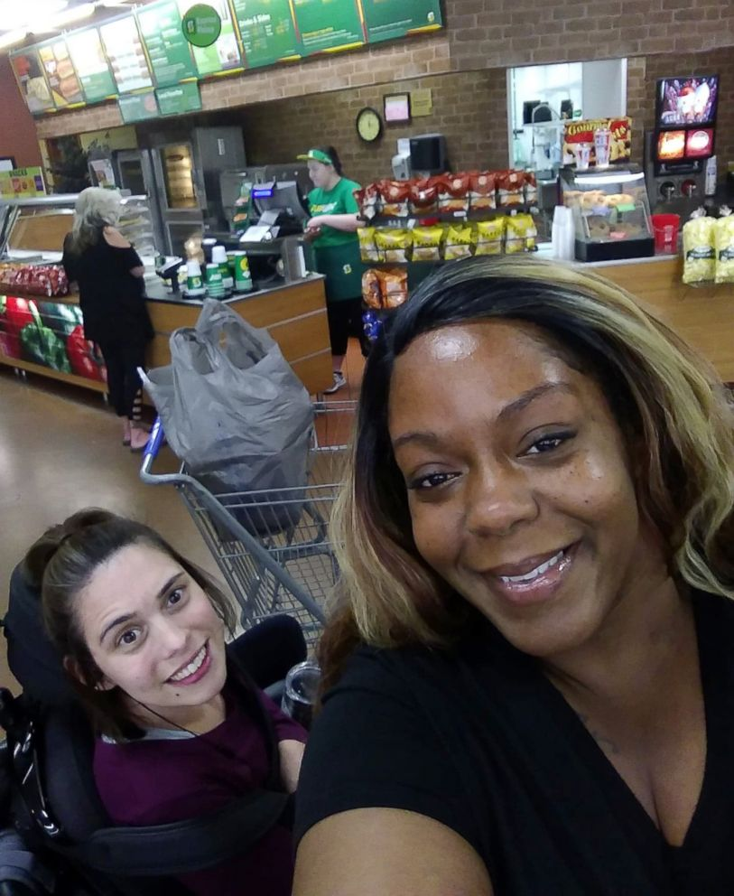 Angela Peters and Ebony Harris in Walmart in Michigan.