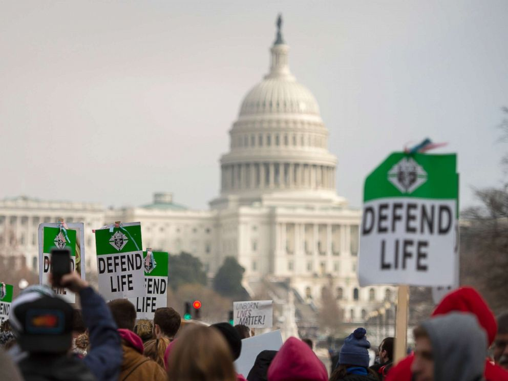 PHOTO: Students and activists carry signs during the annual March for Life in Washington, DC, Jan. 18, 2019.