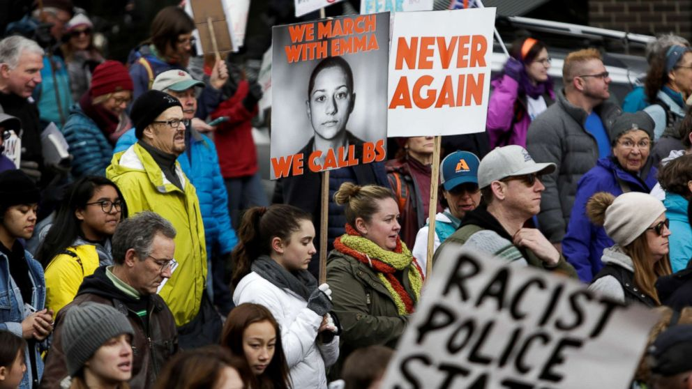 Parkland, Florida school shooting survivor Emma Gonzalez is pictured on a sign during a March for Our Lives demonstration demanding gun control in Seattle, Washington, March 24, 2018.