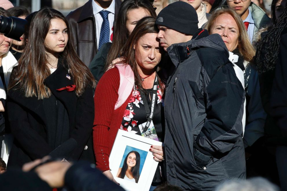 Lori Alhadeff is comforted by her husband Ilan Alhadeff as she holds a photograph of their daughter, Alyssa Alhadeff, 14, who was killed in the shootings at Marjory Stoneman Douglas High School, during a news conference on gun violence, March 23, 2018.