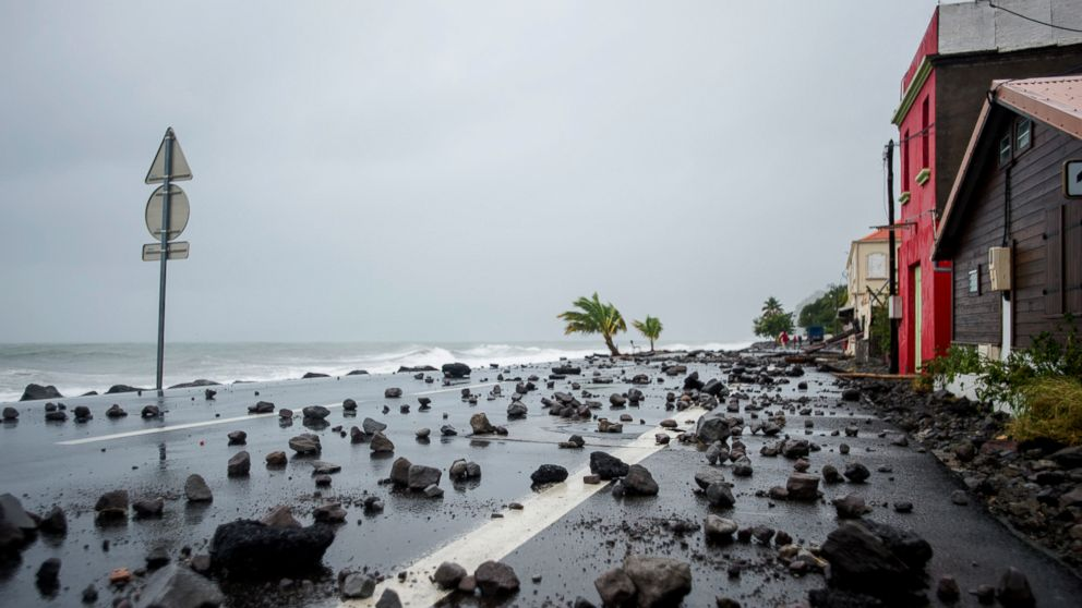 Rocks swept by strong waves onto a road in Le Carbet, on the French Caribbean island of Martinique, after it was hit by Hurricane Maria, on September 19, 2017.