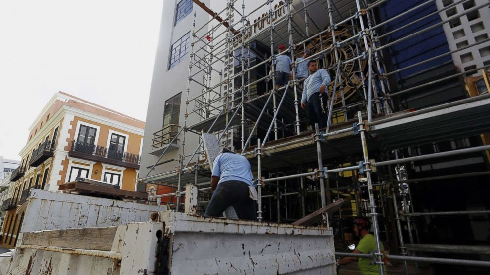 Workers dismantle a scaffold, in San Juan, Puerto Rico, as the city prepares for the arrival of hurricane Maria which is approaching both the Virgin Islands and Puerto Rico with winds of 160 miles per hour, storm surges and torrential rains.