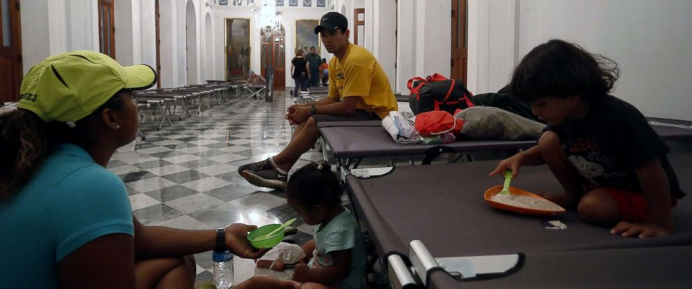 PHOTO: Inhabitants of the La Perla neighborhood of San Juan, P.R. take refuge in the city hall September 19, 2017. The city is preparing for the arrival of hurricane Maria, a category 5 storm.