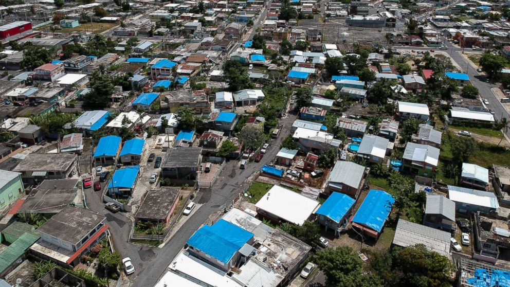 This June 18, 2018, photo shows an aerial view of the Amelia neighborhood in the municipality of Catano, east of San Juan, Puerto Rico.