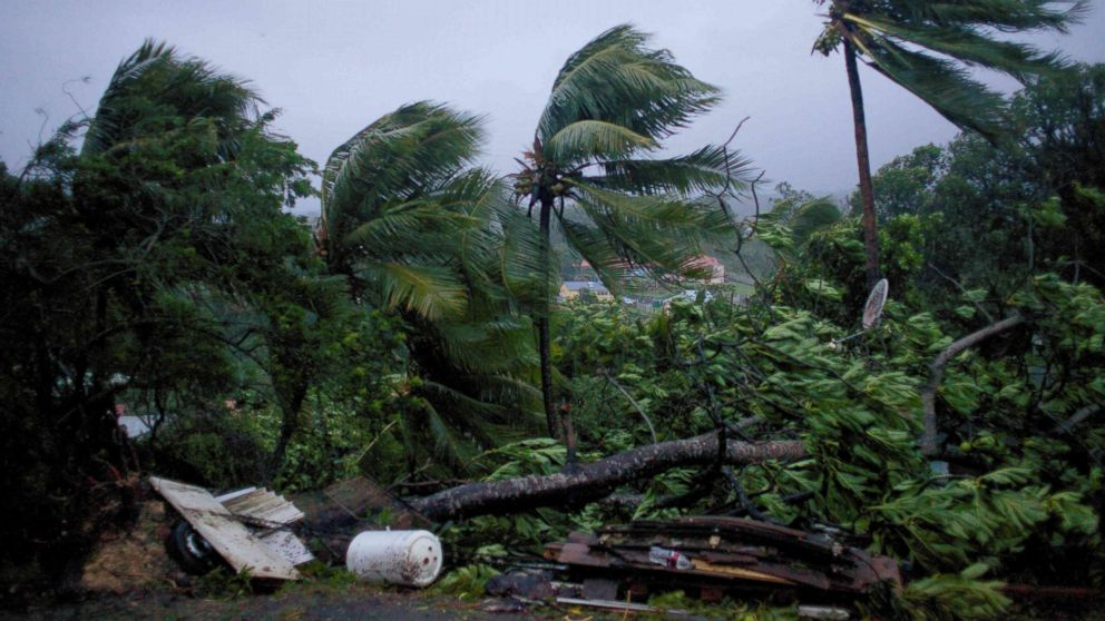 Powerful winds and rains from hurricane Maria as it batters the city of Petit-Bourg on the French Caribbean island of Guadeloupe, Sept. 19, 2017.