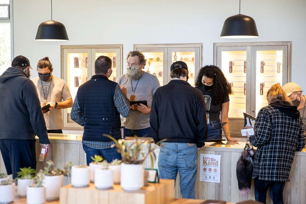 PHOTO: Employees help customers at SeaWeed Co. on the first day of recreational marijuana sales in South Portland, Maine, Oct. 9, 2020.