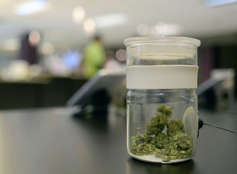 A sample of marijuana is in a jar at Euflora Dispensary in Denver, March 11, 2015.