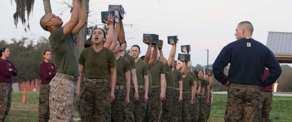 PHOTO: Marine Corps Recruits lift ammunition cans during the Combat Fitness Test on Marine Corps Recruit Depot, Parris Island, S.C., Feb. 15, 2018.