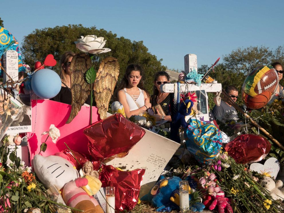 PHOTO: People are pictured at a memorial the day students and parents arrive for voluntary campus orientation at the Marjory Stoneman Douglas High School following last weeks mass shooting in Parkland, Fla., Feb. 25, 2018.