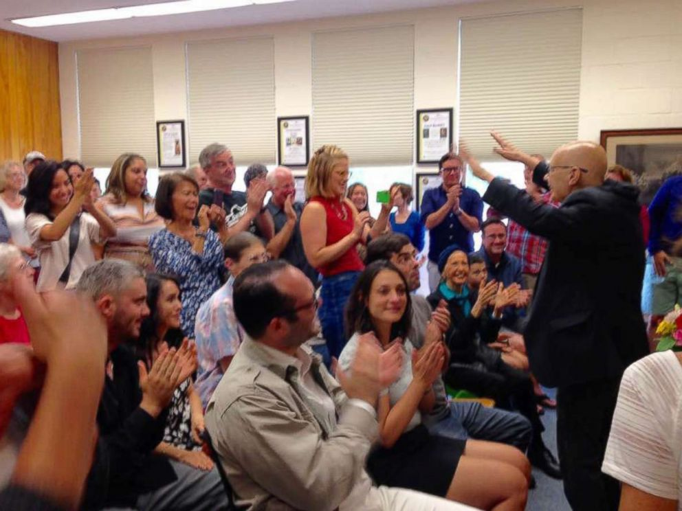 PHOTO: Mark Mooney gets a standing ovation from a packed house at his last public reading of his memoir, Three Cents a Mile, July 30, 2017.