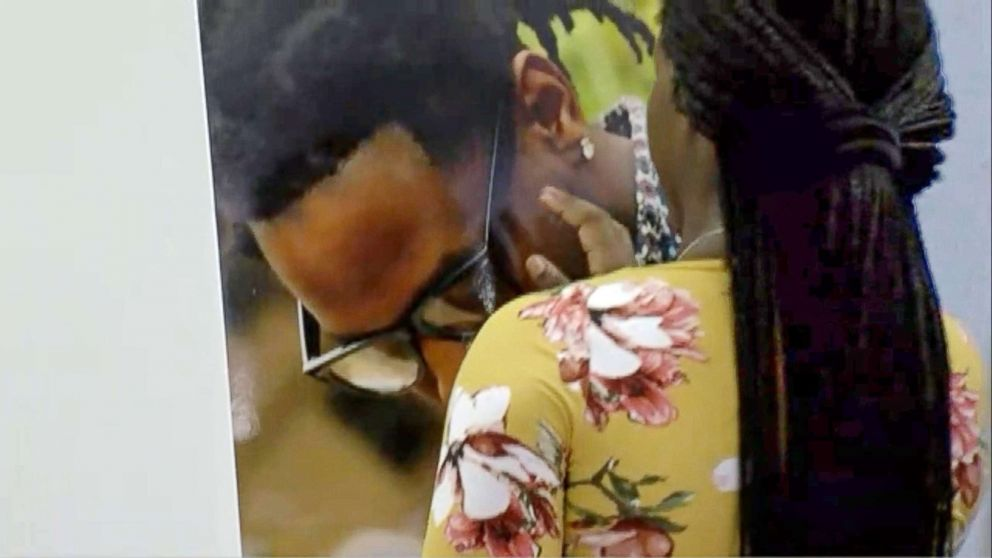 PHOTO: Brittany Jacobs touches photo of her boyfriend, Markeis McGlockton, during a press conference on July 24, 2018 in Clearwater, Fla.