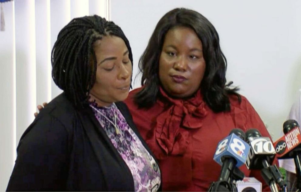 PHOTO: Monica Moore, the mother of Markeis McGlockton, is comforted by family attorney Michele Rayner during a press conference on July 24, 2018 in Clearwater, Fla.