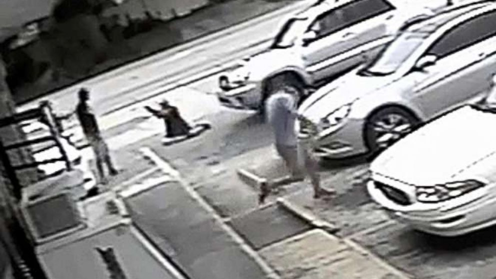 In this Thursday, July 19, 2018 image taken from surveillance video released by the Pinellas County Sheriff's Office, Markeis McGlockton, far left, is shot by Michael Drejka during an altercation in the parking lot of a convenience store in Clearwater, Fla.