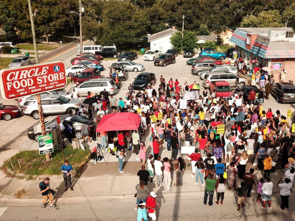 PHOTO: In this Sunday, July 22, 2018 photo, family, friends and demonstrators gather in a parking lot in Clearwater, Fla., where Markeis McGlockton, 28, was shot and killed in an altercation.