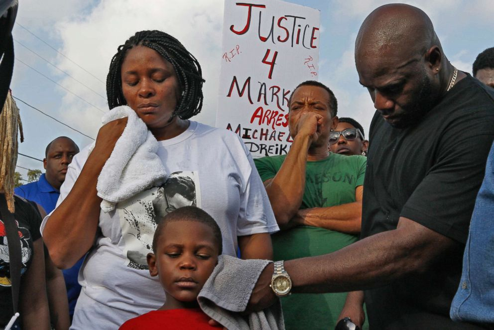 PHOTO: Mark McGlockton's father, Michael McGlockton, wipes the face of his grandson and Markeis's five-year-old son, Markeis McGlockton Jr., as protesters gather to voice their concerns in Clearwater Fla. 2018.
