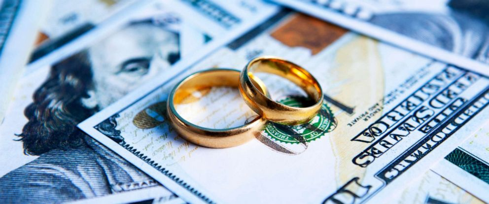 PHOTO: Rings sit on money in this stock photo.