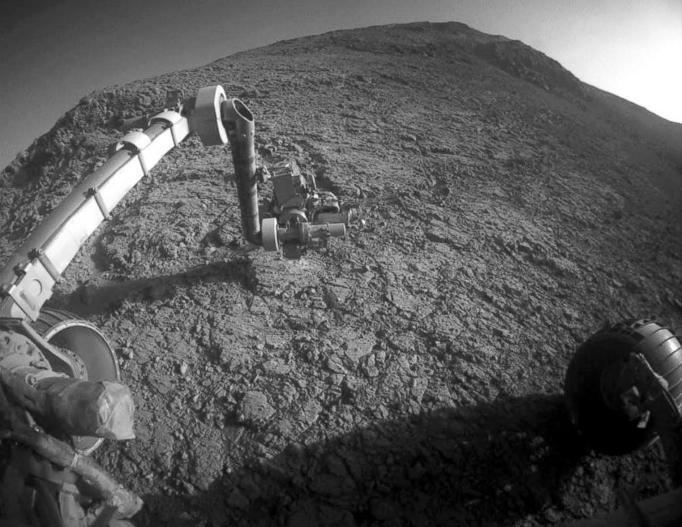 PHOTO: The tool turret at the end of the the Opportunity rovers robotic arm on the southern side of Marathon Valley, which goes through the western rim of Endeavour Crater.