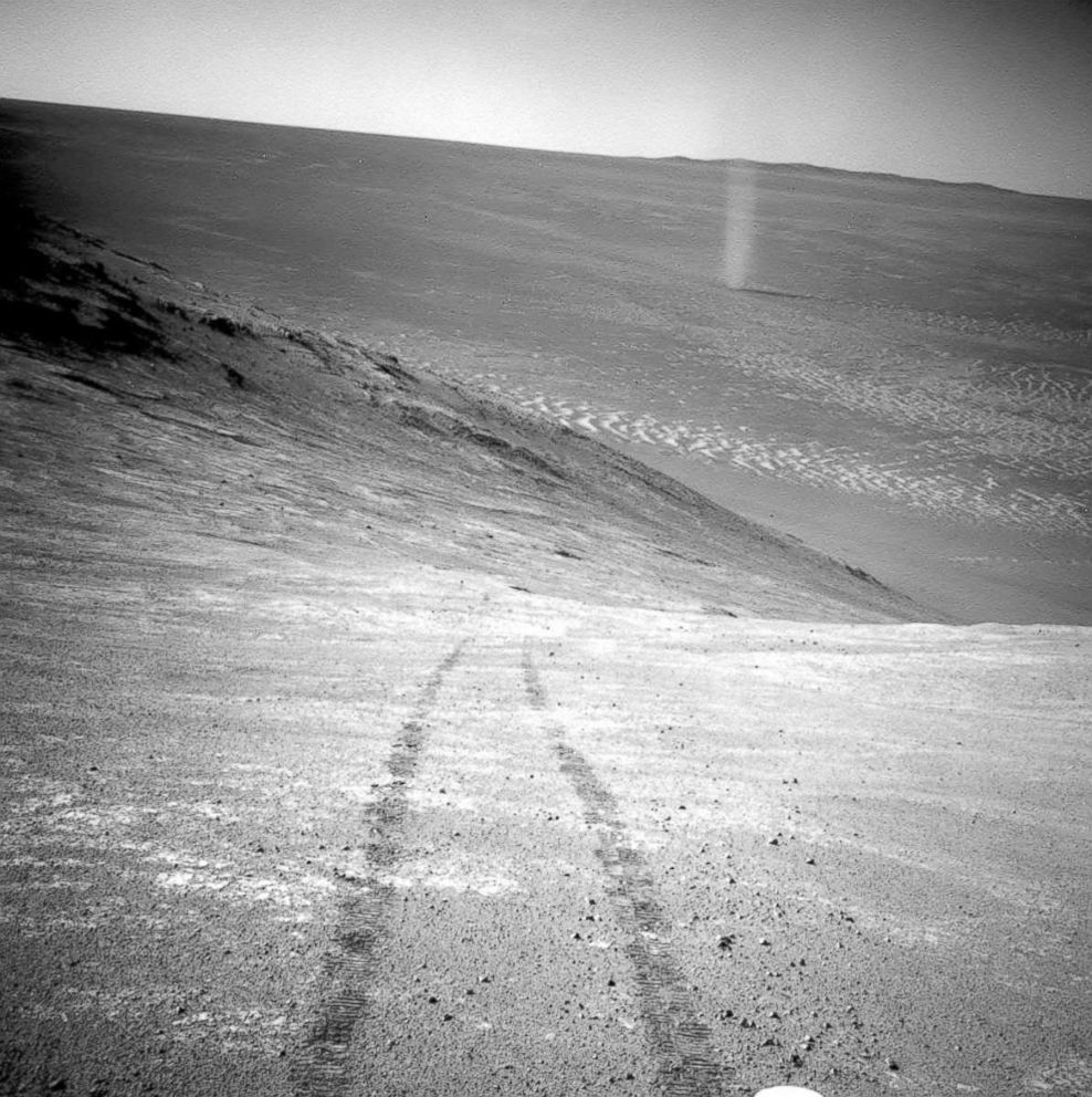 PHOTO: A dust devil in a valley on Mars, seen by the Opportunity rover perched on a ridge.
