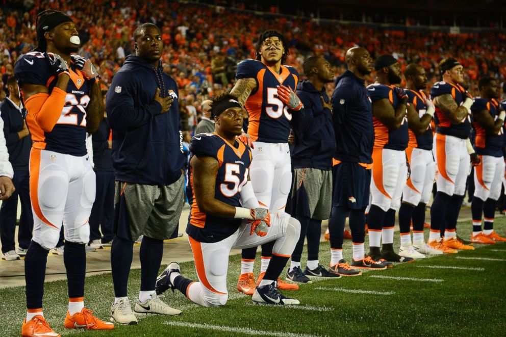 PHOTO: Brandon Marshall (54) of the Denver Broncos kneels as Shane Ray (56) puts his hand on his shoulder for the National Anthem during the first quarter, Oct. 24, 2016.