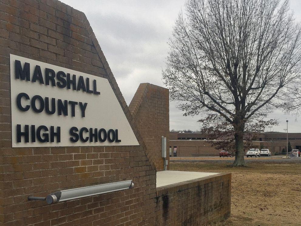 PHOTO: Authorities investigate the scene of fatal school shooting, Jan 23, 2018, in Benton, Ky.