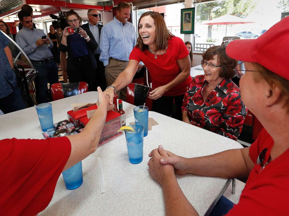 PHOTO: Arizona Republican senatorial candidate Martha McSally, speaks with voters, Nov. 6, 2018, at Chases diner in Chandler, Ariz.