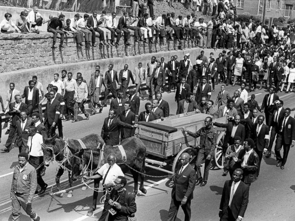 PHOTO: View of the casket of the Reverend Martin Luther King, Jr loaded onto a wooden farm wagon and pulled by mules during his funeral procession in Atlanta, Georgia, April 9, 1968.