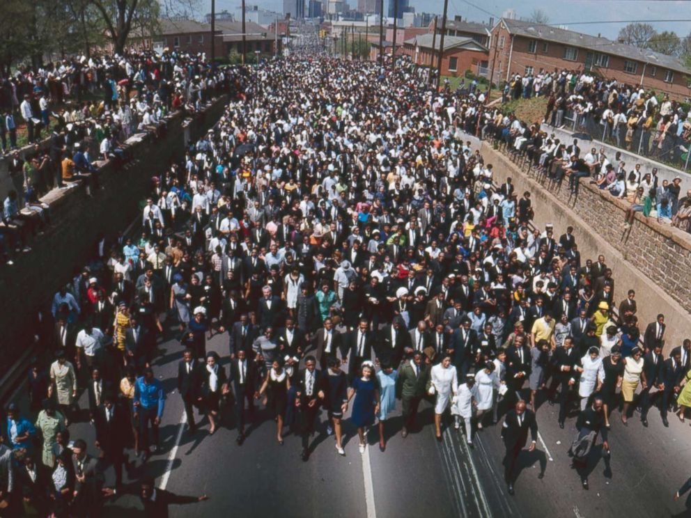 PHOTO: Funeral procession of 1300 people walking from Ebenezer Baptist Church to Morehouse College in honor of Martin Luther King, Jr., Atlanta. April 9, 1968.