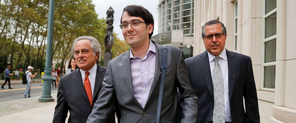 PHOTO: Former biotech CEO Martin Shkreli, center, leaves federal court with his attorney Benjamin Brafman, left, in New York, July 27, 2017.