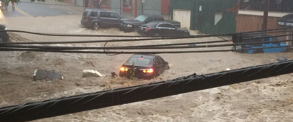 Flash floods turn Maryland town's Main Street into raging ...