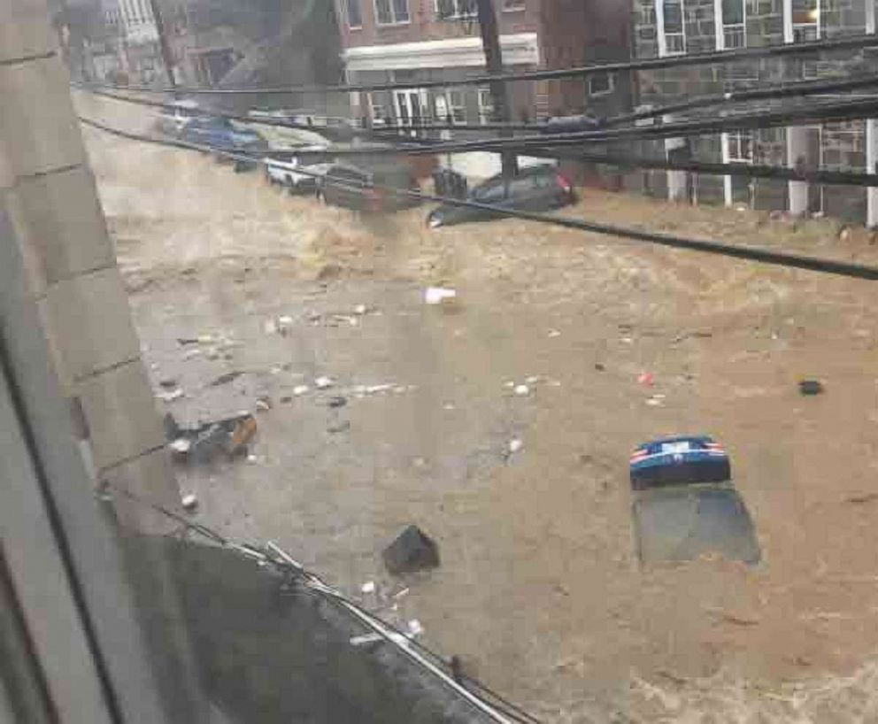 Video shows flash flood sweeping through Baltimore-area street after heavy rains