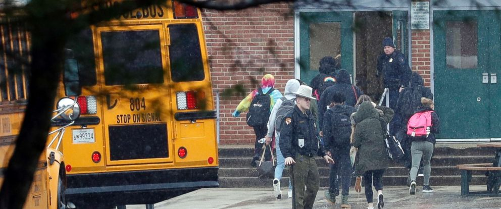 PHOTO: Police move students into a different area of Great Mills High School, the scene of a shooting, March 20, 2018 in Great Mills, Md.