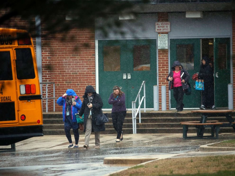 PHOTO: Teachers and school employees depart Great Mills High School, the scene of a shooting, March 20, 2018 in Great Mills, Md.
