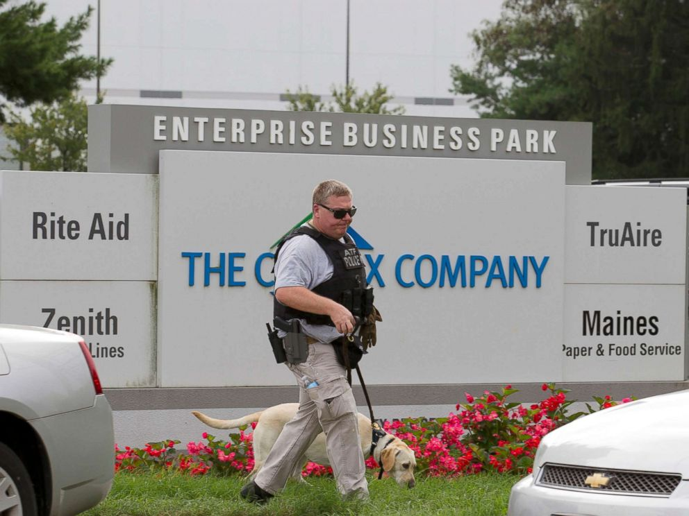 PHOTO: ATF police officer with a sniffing dog walks out the industrial complex in Harford County, Md., Sept. 20, 2018.