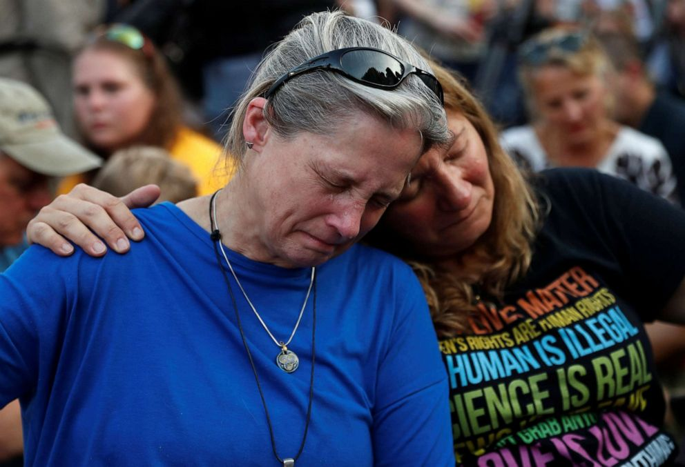 PHOTO: Community members Carol Geithner, left, and Yasemine Jamison take part in a candlelight vigil near the Capital Gazette, the day after a gunman killed five people inside the newspapers building in Annapolis, Md., June 29, 2018.