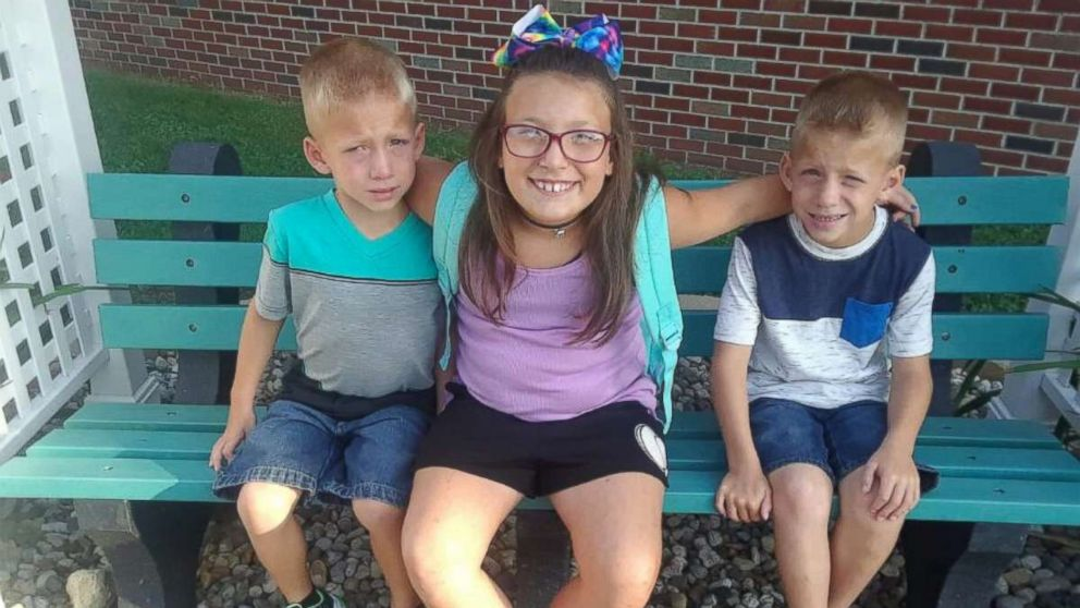 Twin six-year-old brothers Mason and Xzavier Ingle are pictured with their nine-year-old sister Alivia Stahl in an undated family photo. The three were struck and killed by a car near Rochester, Ind., on Oct. 30, 2018.