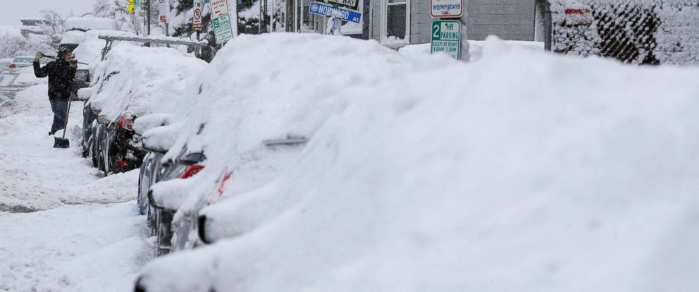 PHOTO: A driver shovels out his car following a winter snow storm in Somerville, Mass., March 4, 2019.