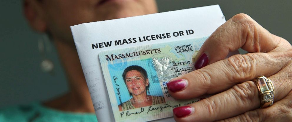 PHOTO: Paulette Renault-Caragianes displays her new drivers license at her office in Lowell, MA on March 29, 2018.