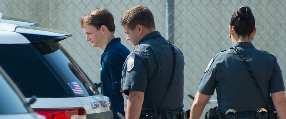 PHOTO: In this Wednesday, Oct. 11, 2017 file photo, Matthew Alexander Naquin is escorted from the building by LSU Police Dept. officers after being booked on a hazing charge, in Baton Rouge, La.